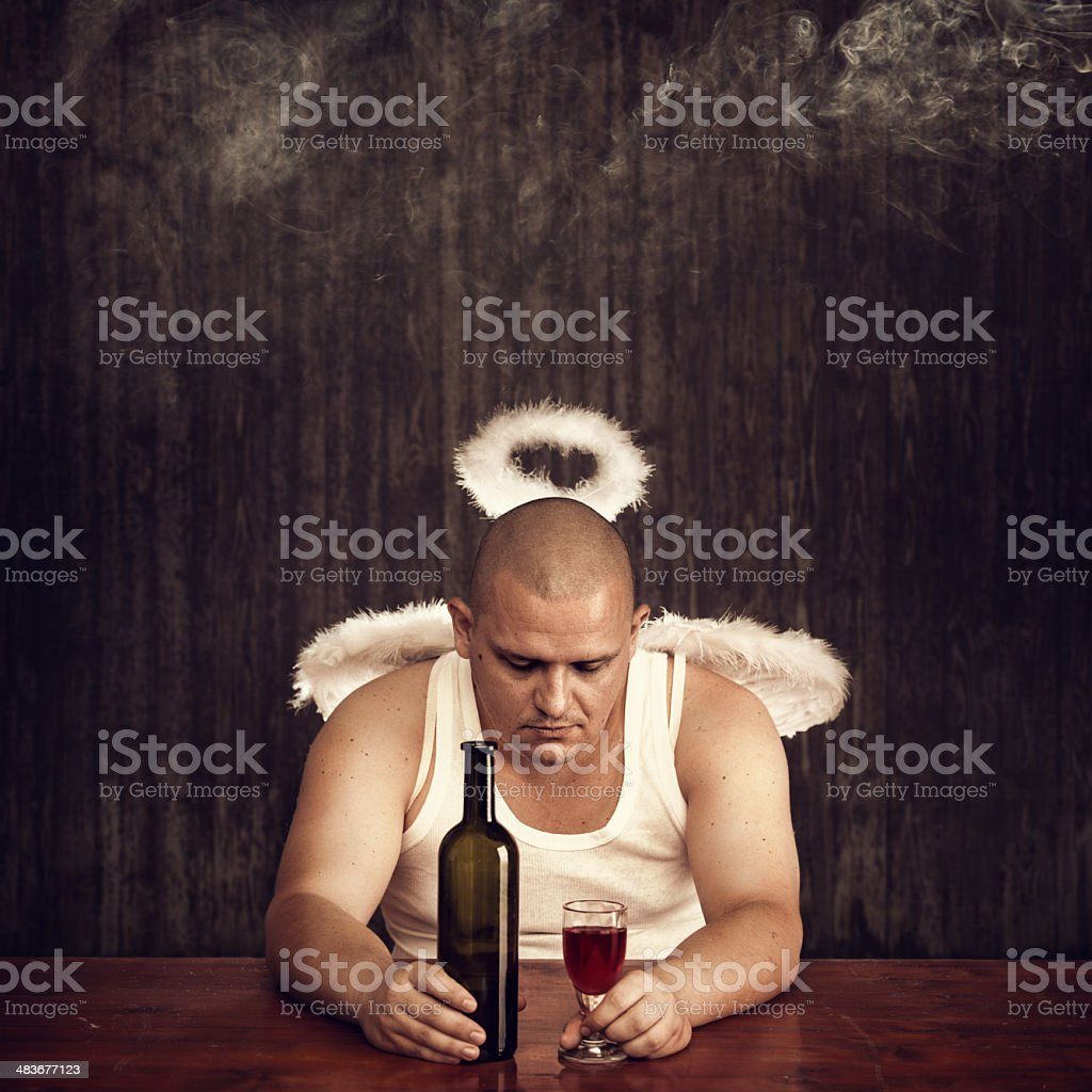 angel drinking in a pub stock photo