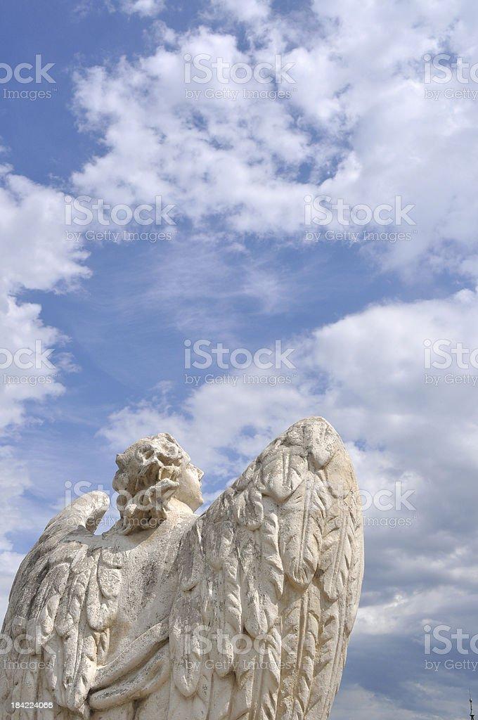 Angel facing blue sky I stock photo