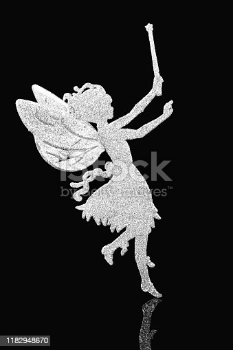 Angel figure for hanging on Christmas tree on black background.