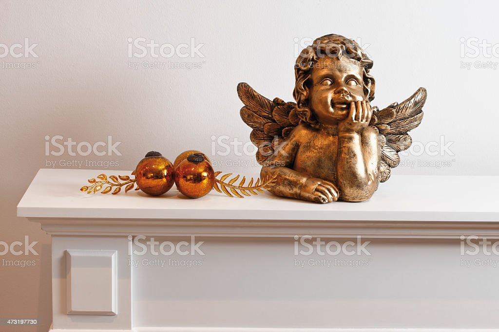 Angel figurine and decoration on shelf stock photo
