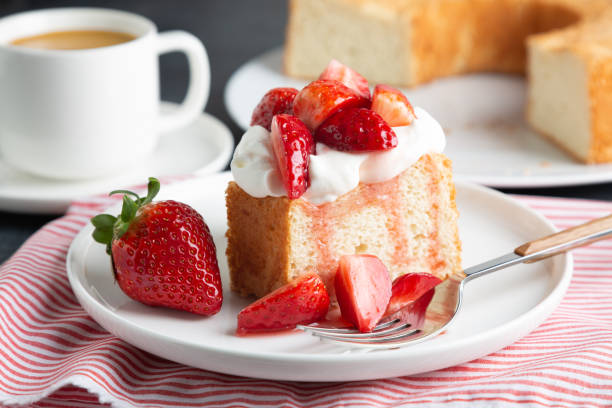 Angel food cake with whipped cream and strawberries stock photo