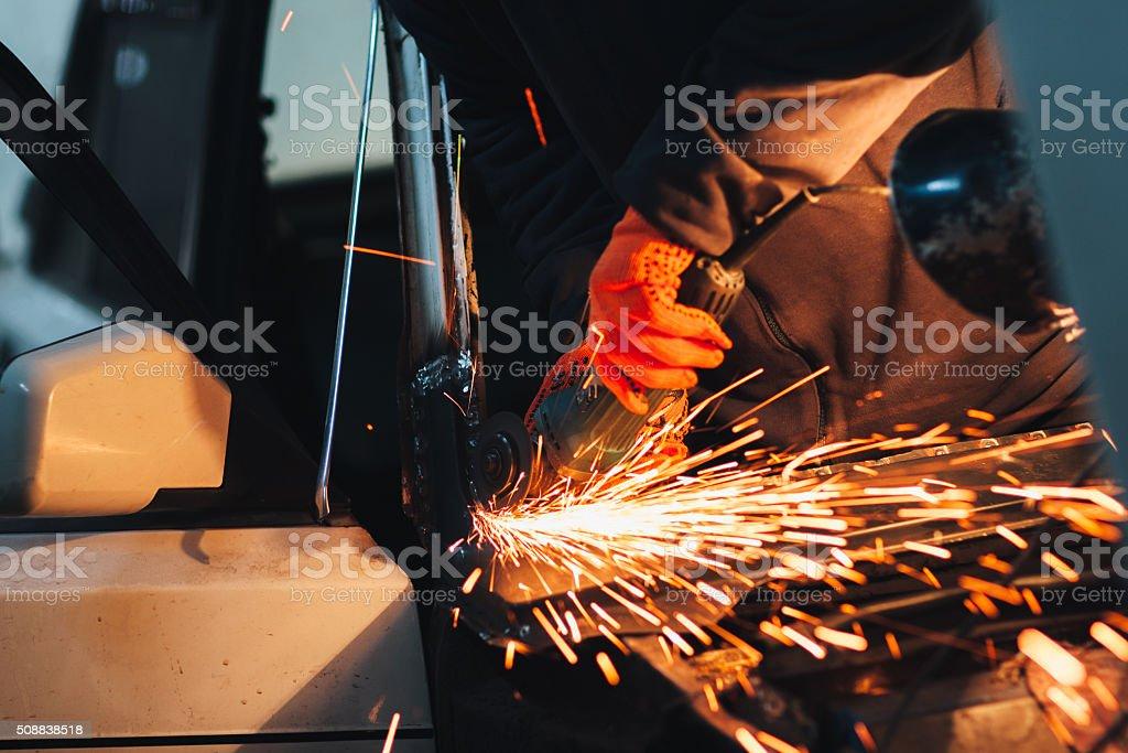 Angel grinder make a flash sparks stock photo