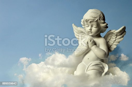 istock Angel guardian on the cloud 889559642
