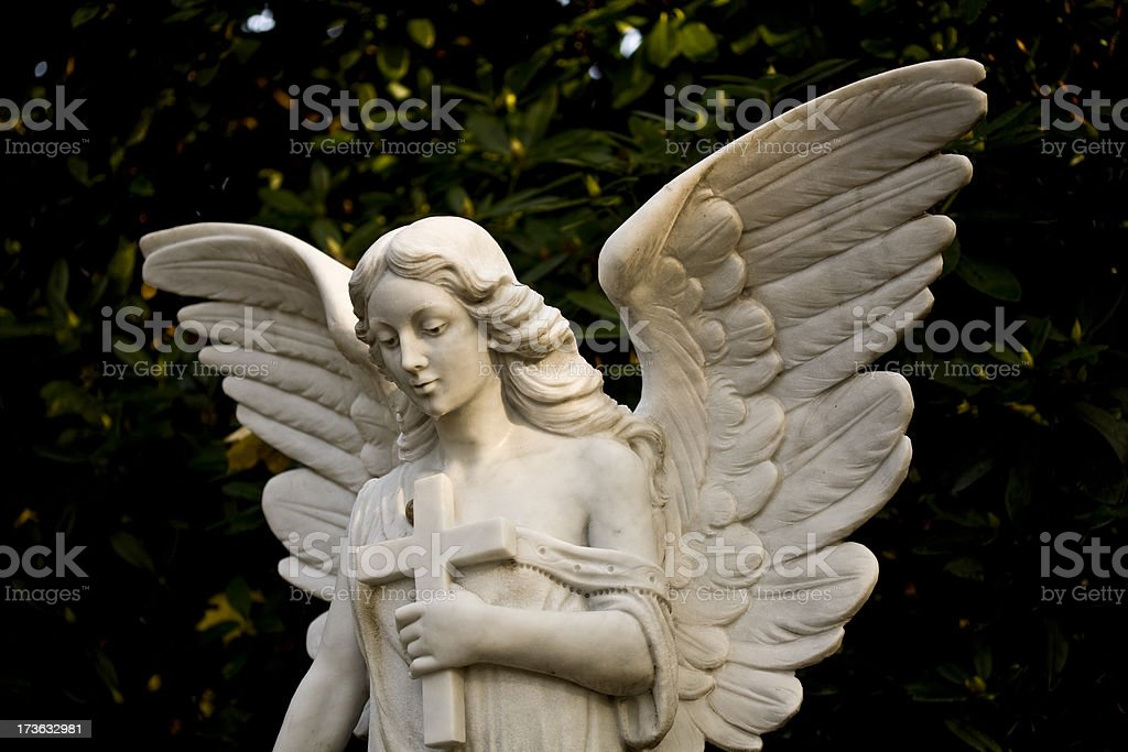 angel holding a cross royalty-free stock photo