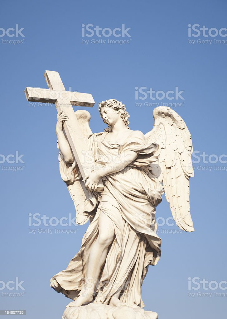 Angel Holding a Cross Statue in Rome royalty-free stock photo