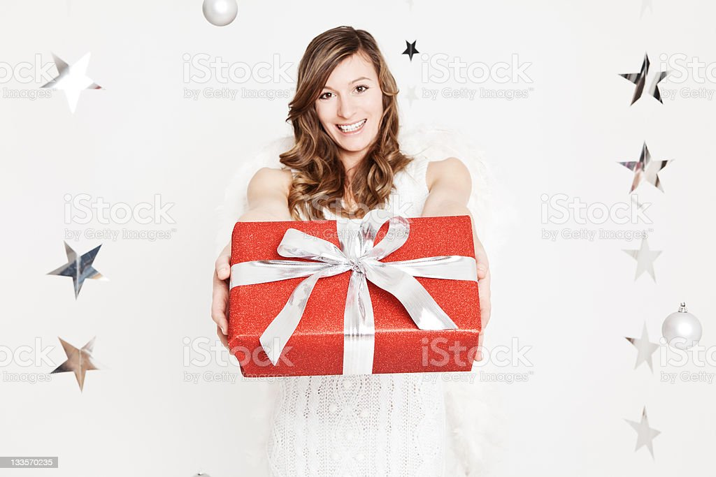 Angel holding a present royalty-free stock photo