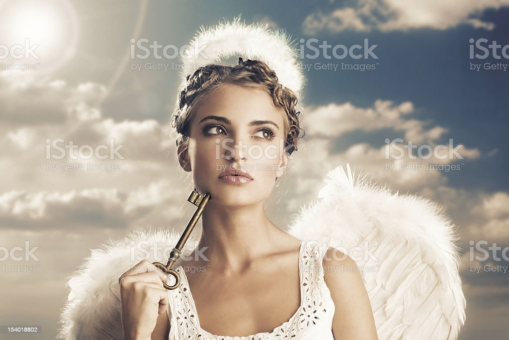 angel holding the key of heaven stock photo
