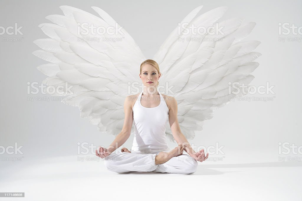 Angel in meditation stock photo