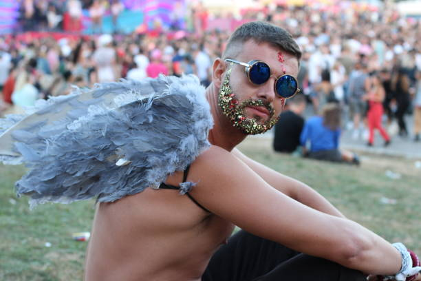 Angel in the crowd during a festival stock photo