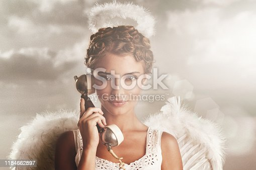 istock Angel in the sky with receiver 1184662897