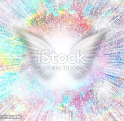 Shining angel wings in rays of light. 3D rendering