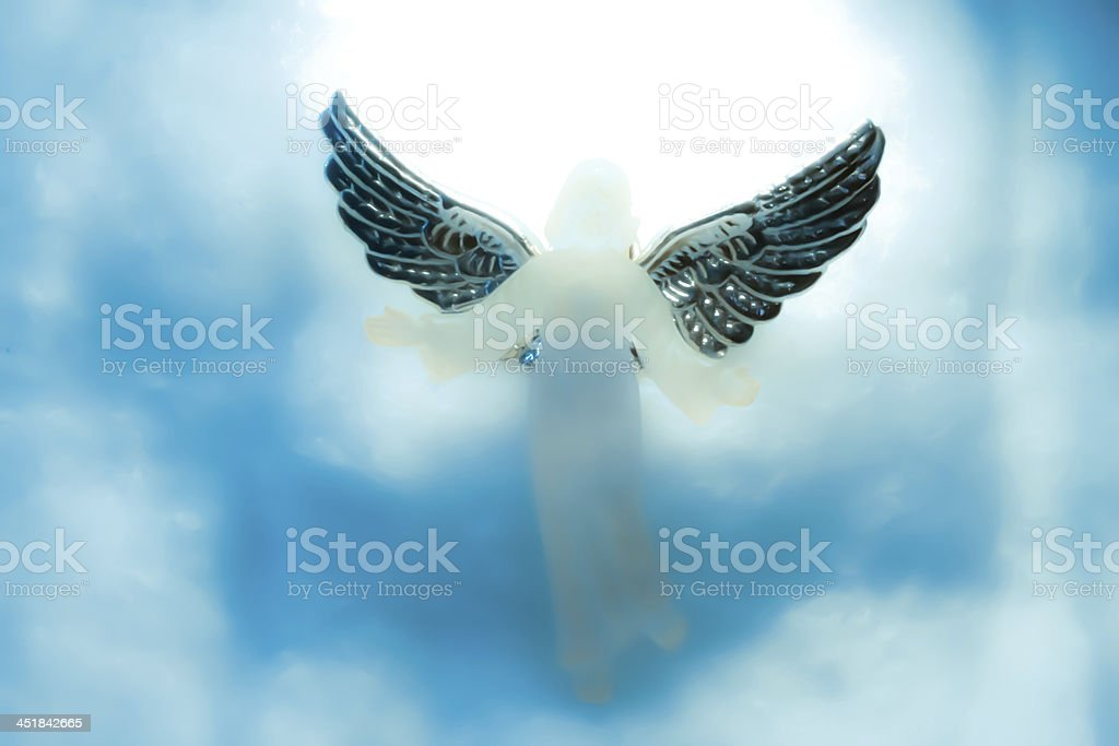 angel looking down from heaven stock photo