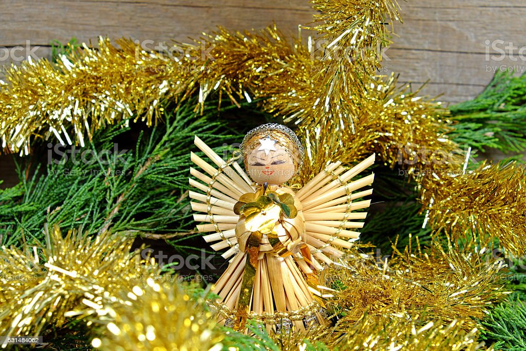 Angel made of straw with a star on his forehead stock photo