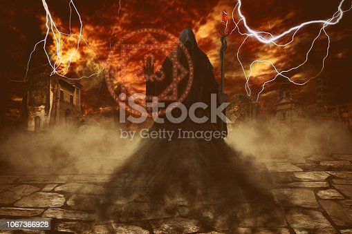 istock Angel of death casting a spell of destruction with a magic staff over apocalypse background 1067366928