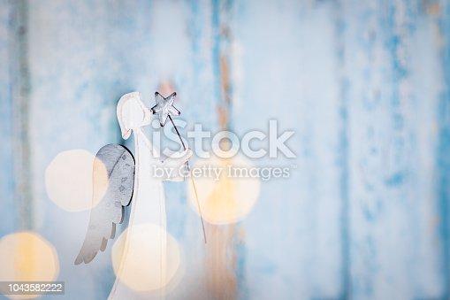 istock Angel on Christmas background 1043582222