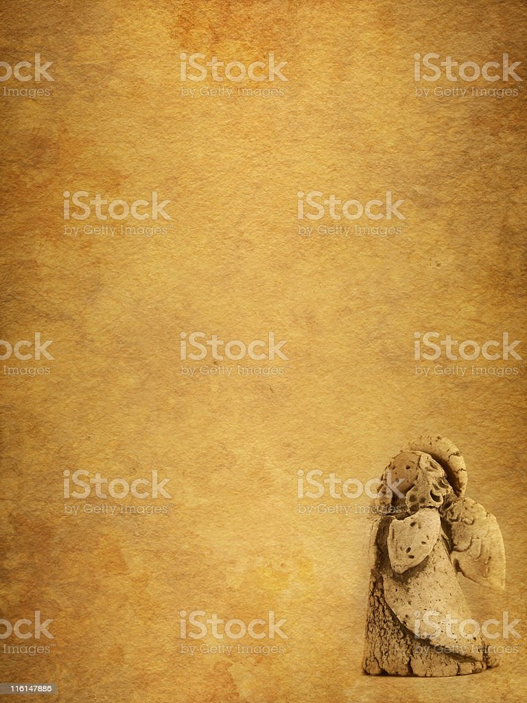 angel on old stained paper stock photo