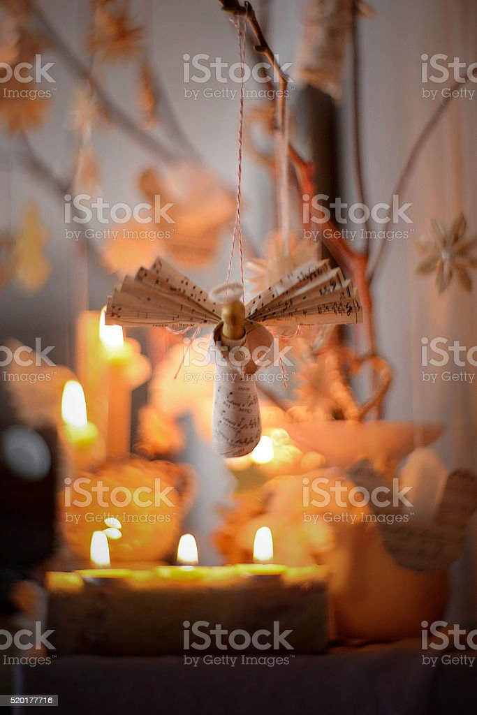 angel ornament over candles stock photo