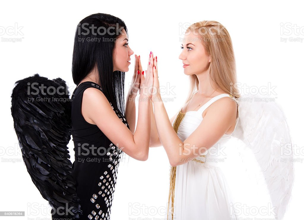 Angel playing pat-a-cake with black angel stock photo