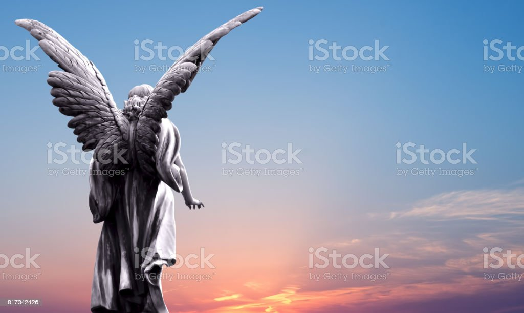 Angel sculpture over bright sky stock photo