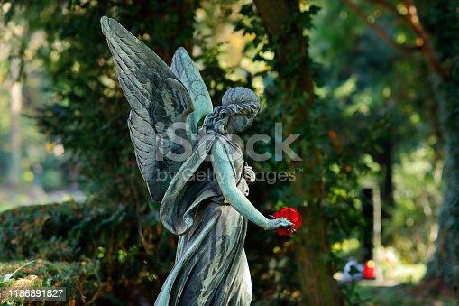 Walking angel sculpture on a cemetery