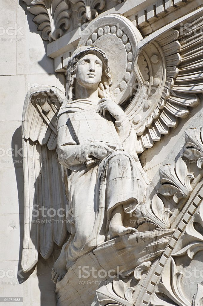 Angel Sculpture with Wings and Holy Bible royalty-free stock photo