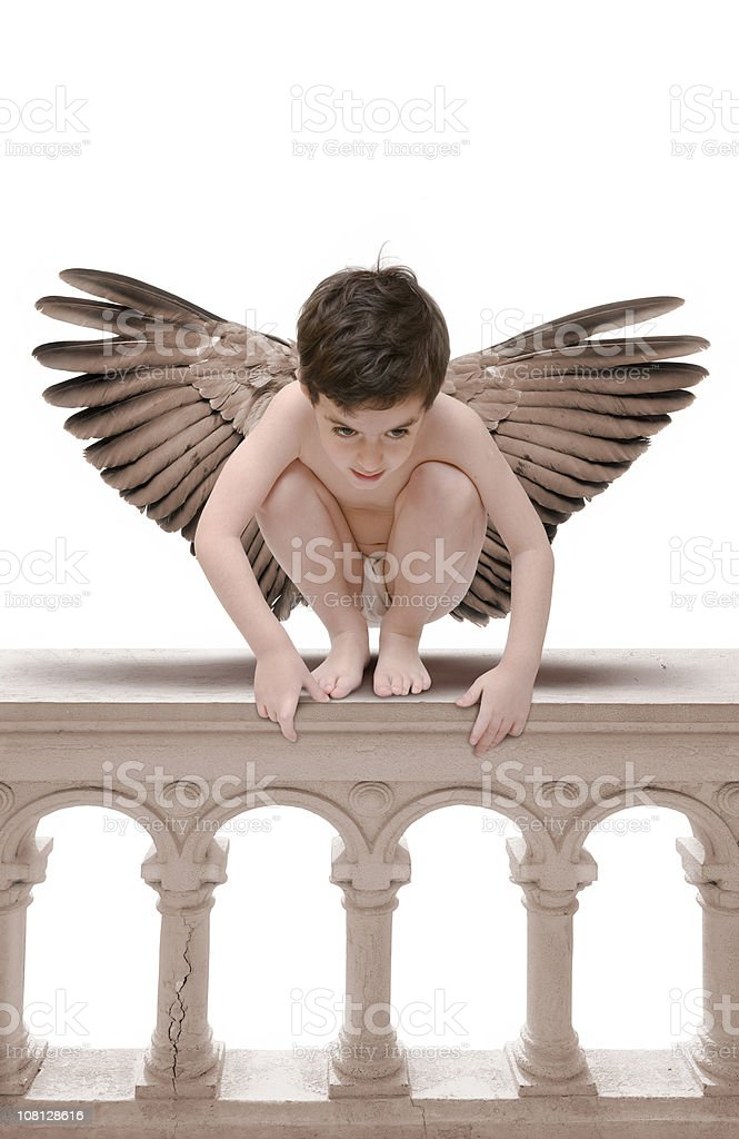 Angel sitting on balustrade stock photo