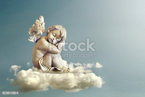 istock Angel sleeping on the cloud 623910924