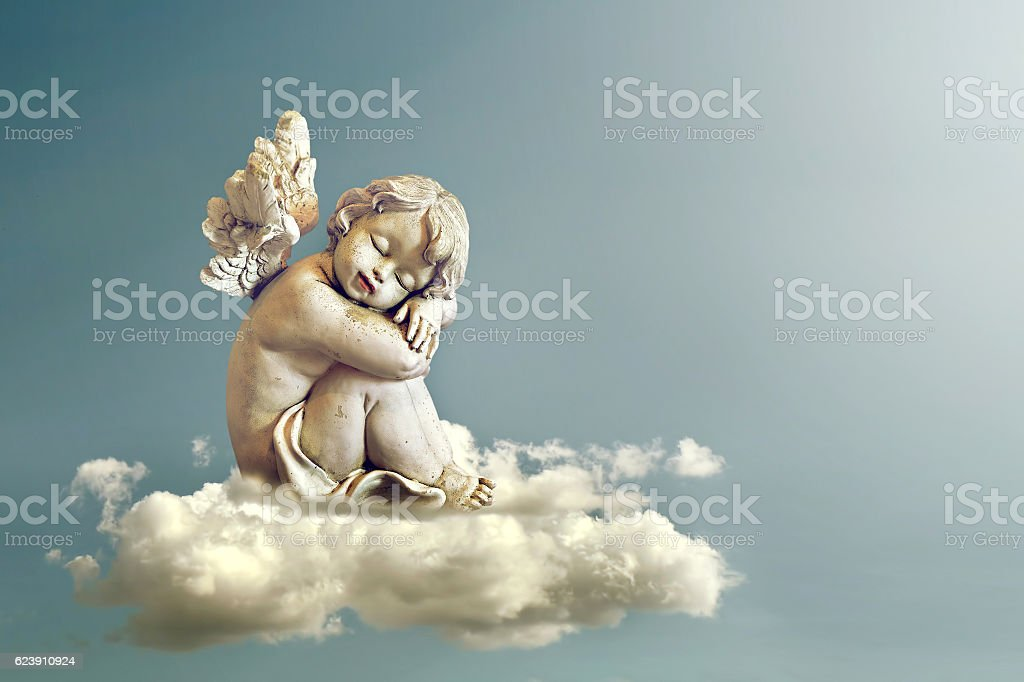 Angel sleeping on the cloud stok fotoğrafı