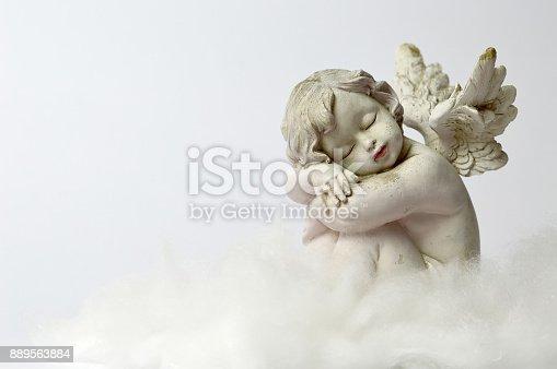 istock Angel sleeping on the cloud 889563884