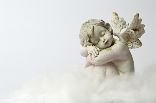 istock Angel sleeping on the cloud 889563884