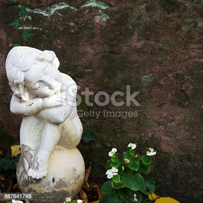 istock Angel statue at cementery. Relogious symbol, copy space 887641748