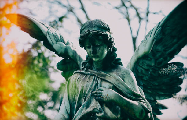 Angel statue at the Melaten graveyard, Cologne stock photo