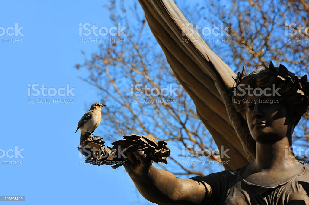 Angel Statue Holds Olive Branch stock photo