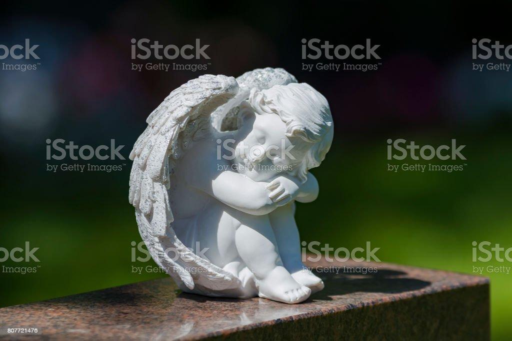 Angel statue on gravestone stock photo