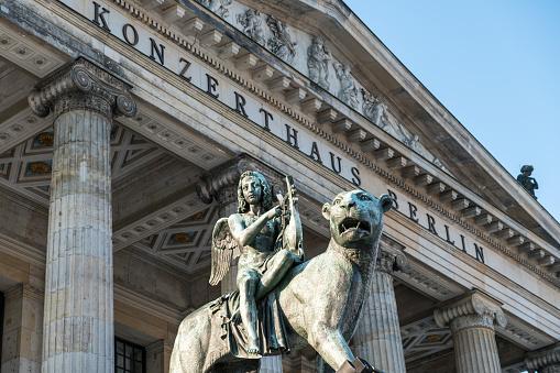 Angel statue on lion at concert house Berlin, Gendarmenmarkt