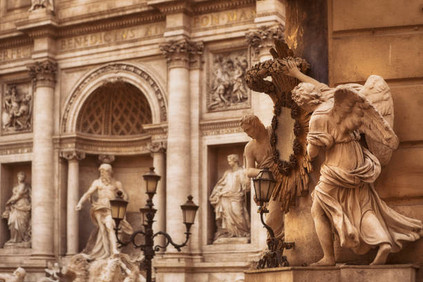 Angel Statues and Trevi Fountain in Rome, Italy The Trevi Fountain is a fountain in the Trevi district in Rome, Italy lazio stock pictures, royalty-free photos & images