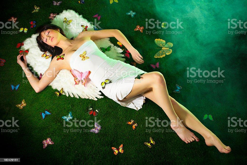 Cтоковое фото Ангел в окружении бабочки