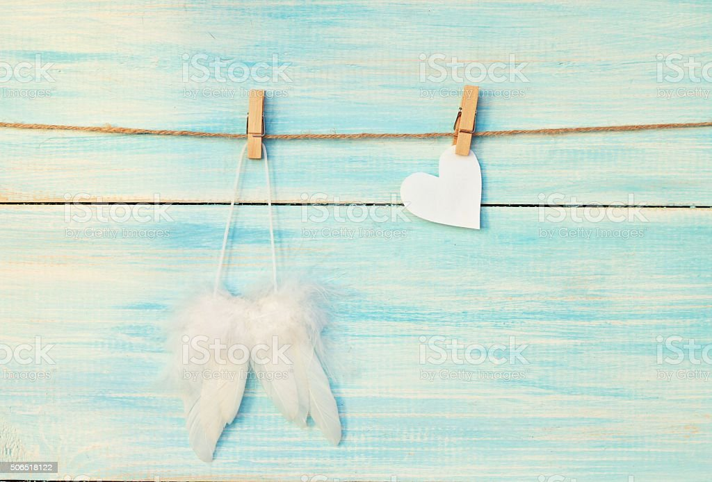 Angel wings and heart stock photo