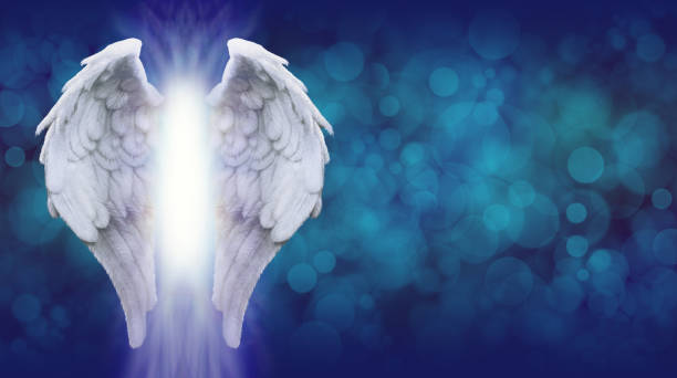 Angel Wings on Blue Bokeh Banner stock photo