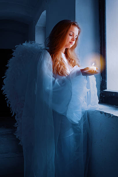 angel with a candle stock photo