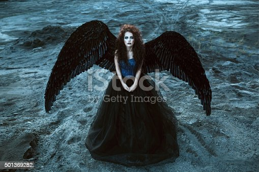 istock Angel with black wings 501369282
