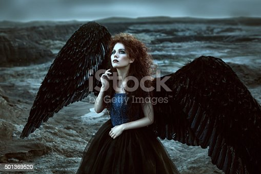 istock Angel with black wings 501369520