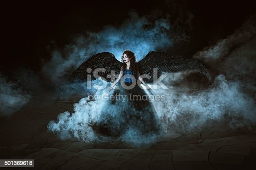 istock Angel with black wings 501369618