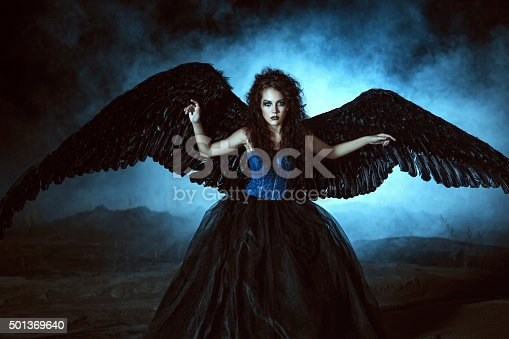 istock Angel with black wings 501369640
