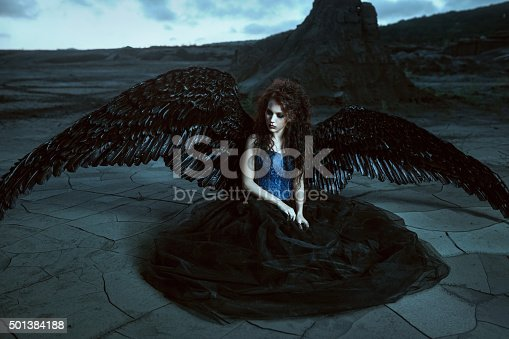 istock Angel with black wings 501384188