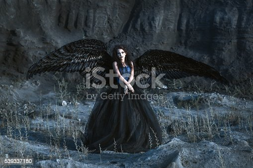 istock Angel with black wings 539337180