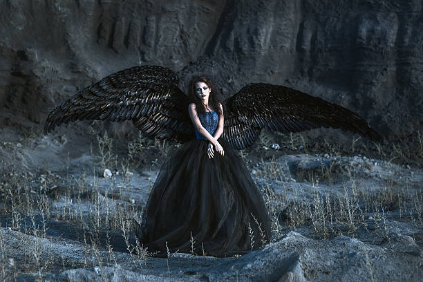 angel with black wings - gothic fashion stock photos and pictures