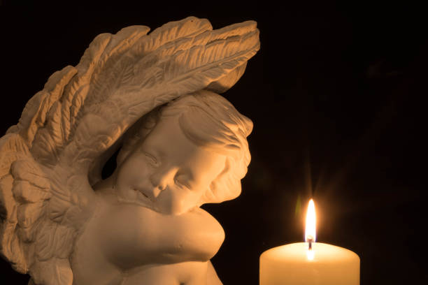 Angel with candles stock photo