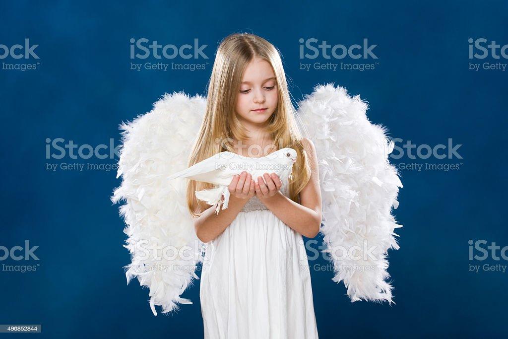 Angel with dove stock photo