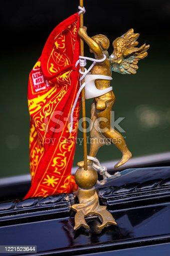 Angel with flag and Venetian Gondola interior detail - Venice, Veneto - Italy